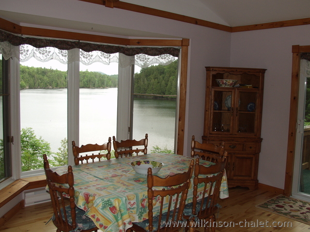 Cottage dining room overlooking Malone Bay,                 Lac des trente et un milles (31 miles lake),                 Bouchette, Quebec