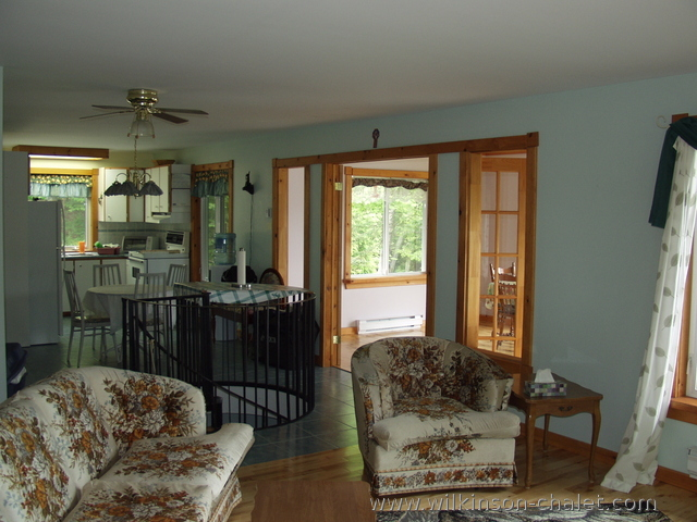 Cottage family room looking toward the kitchen,        Bouchette, Quebec