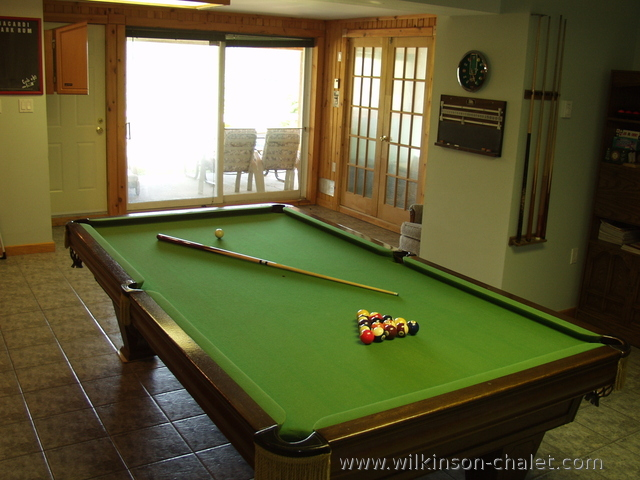 Pool table in cottage basement recreation room
