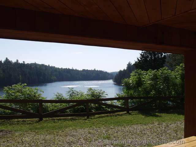 View from the cottage covered patio during the Summer,        overlooking Malone Bay,        Lac des trente et un milles,        Bouchette, Quebec