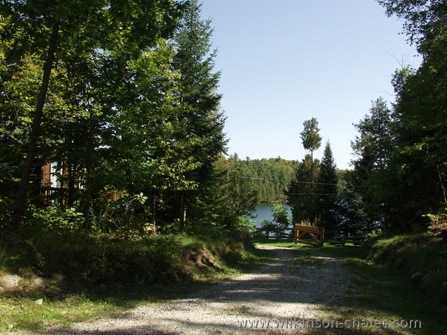 Cottage wrap-around driveway during the Summer,        Looking toward Malone Bay,        Lac des trente et un milles (31 miles lake),        Bouchette, Quebec